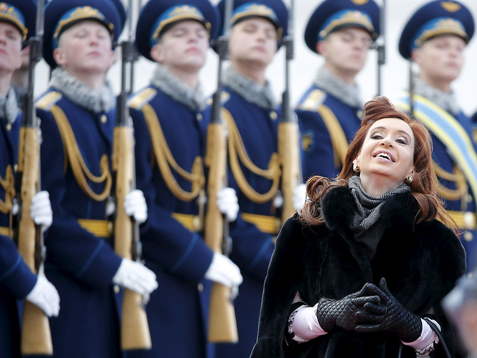 Argentine President Cristina Fernandez reacts as she inspects thehonour guard during a welcoming ceremony upon her arrival at Moscow'sVnukovo airport, April 21, 2015. Fernandez is in Russia for anofficial visit.