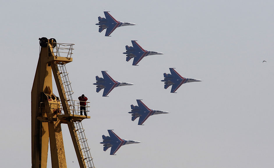 """The Russkiye Vityazi (Russian Knights) aerobatic team performs a demonstration flight during an air show at a promotional event of the contract service in the Russian army as part of the """"Contract Service in the Russian military is your choice!"""" campaign"""