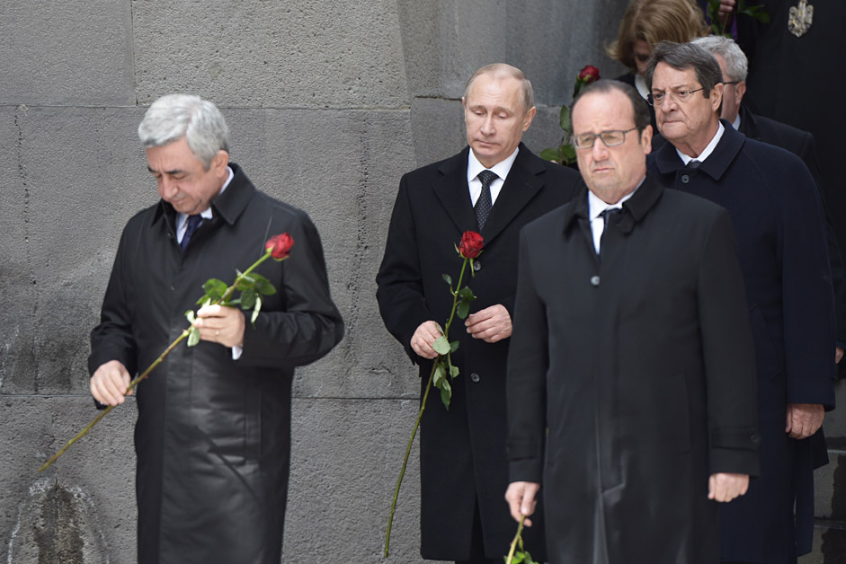 Armenia's president Serzh Sargsyan, Russia's president Vladimir Putin, France's president Francois Hollande and Nicos Anastasiades (L-R), president of Cyprus, seen during a flower laying ceremony on the grounds of the Tsitsernakaberd Armenian Genocide memorial complex.