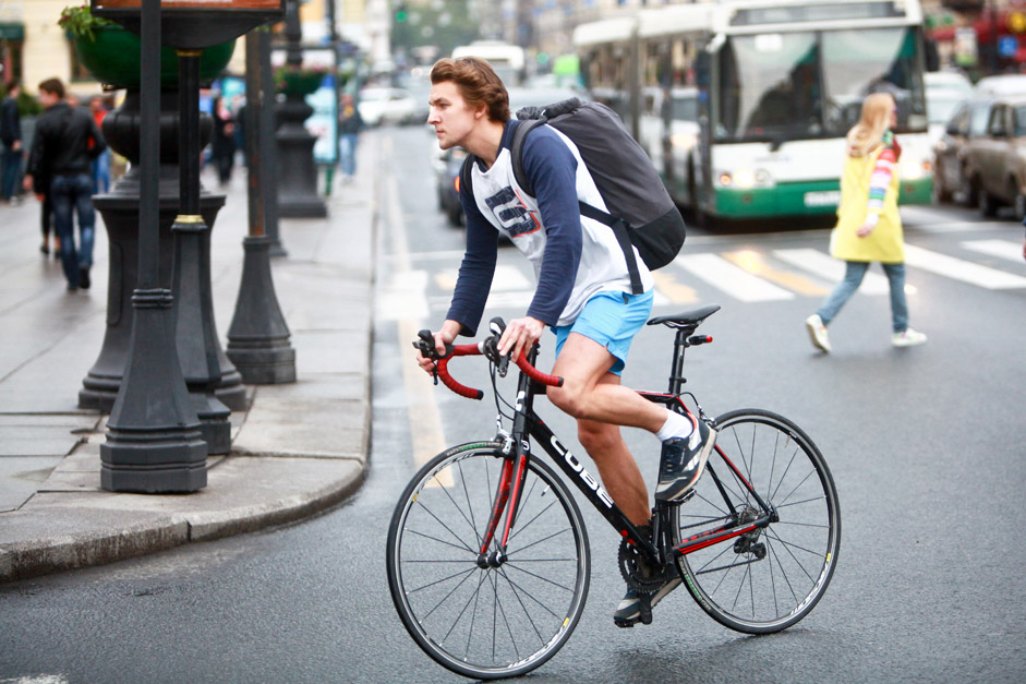 A young man riding a bicycle on Bike to Work Day