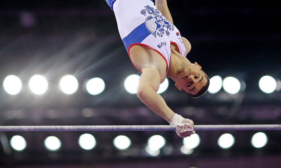 Nikolai Kuksenkov of Russia competes on the horzontal bars during the men's gymnastics team event at the 1st European Games in Baku, Azerbaijan, June 15 , 2015