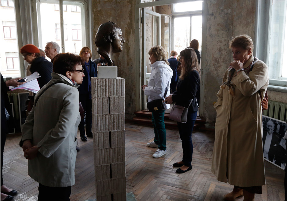 People visit the museum of the Nobel Prize winner and Soviet poet-dissident Joseph Brodsky in downtown St. Petersburg, May 24. The museum was open to the day of the poet's 75th anniversary of birth.