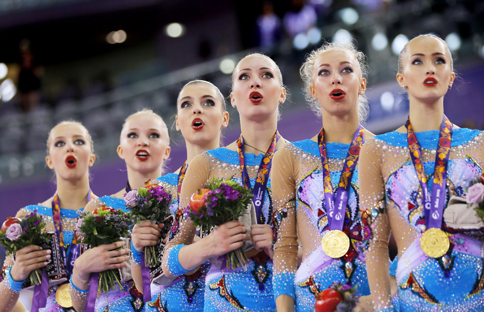 Members of the gold medalist team of Russia sing the national anthem during the medal ceremony at the Gymnastics Rhythmic Group All-Around Final event at the Baku 2015 European Games at the National Gymnastics Arena in Baku, Azerbaijan, 17 June 2015.