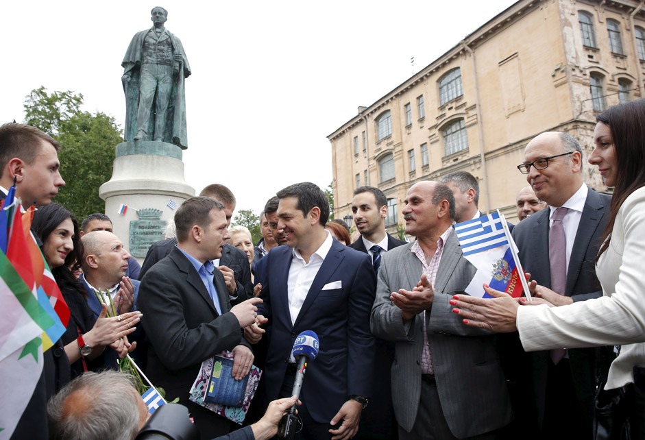 Greek Prime Minister Alexis Tsipras (C) speaks with Greek expatriates in frot of the statue of Russian-born founder of modern Greek state Ioannis Kapodistrias in St. Petersburg, Russia, June 19, 2015