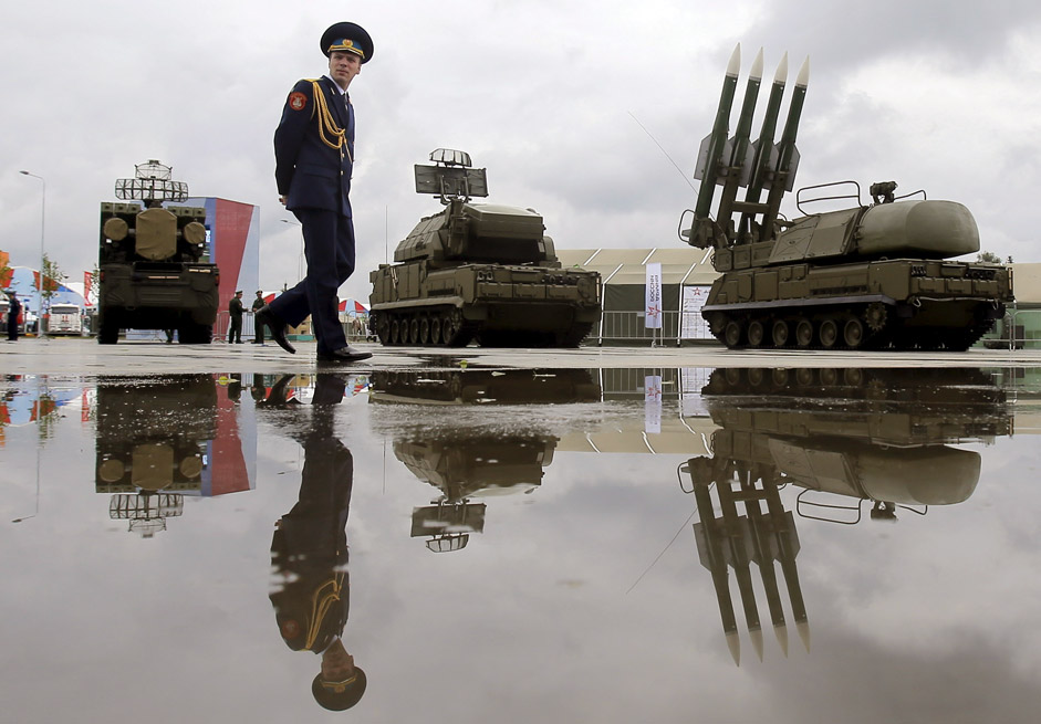 A Russian serviceman walks past the Buk-1M missile system at the Army-2015 international military forum in Kubinka, outside Moscow, Russia, June 16, 2015.