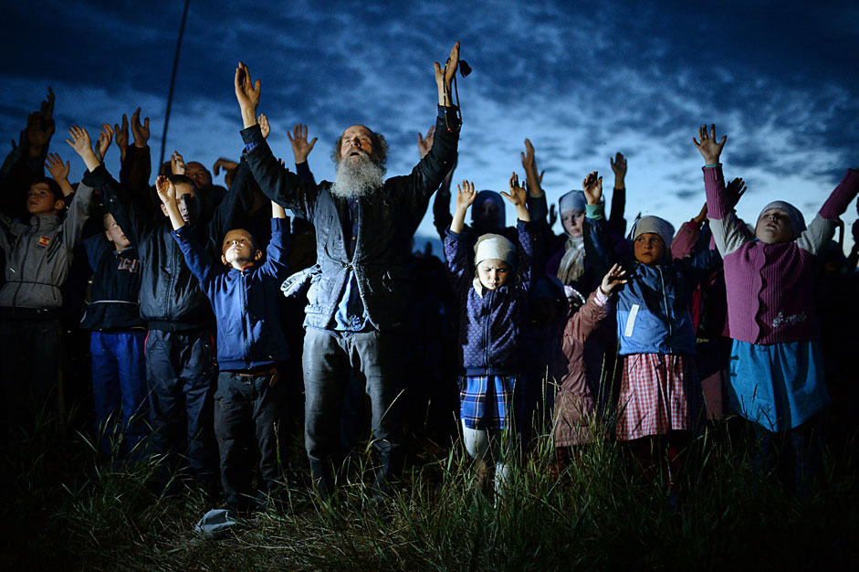 Believers pray in the village of Poteryayevka in the Altai Territory.