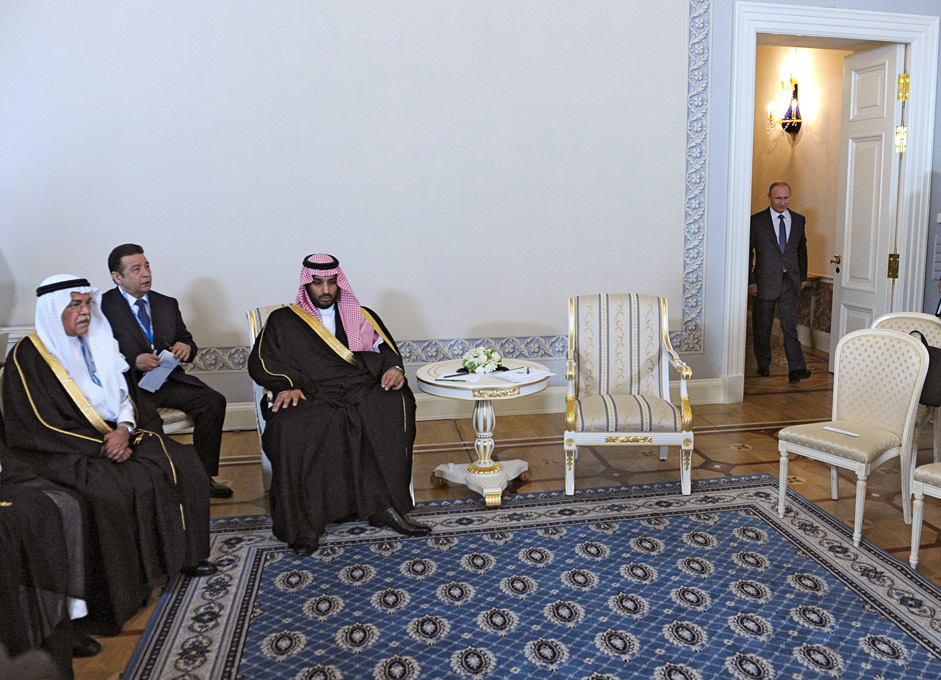 Russian President Vladimir Putin (R) enters for a meeting with Saudi Defence Minister Prince Mohammad bin Salman Al Saud (3-L) at the Konstantin (Konstantinovsky) Palace in St. Petersburg, Russia, 18 June 2015, on the sidelines of the St. Petersburg International Economic Forum.