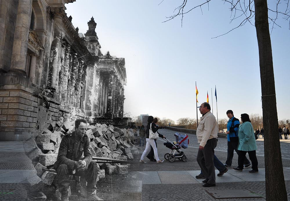 Berlin, 1945-2010. German soldier in front of the vanquished Reichstag.