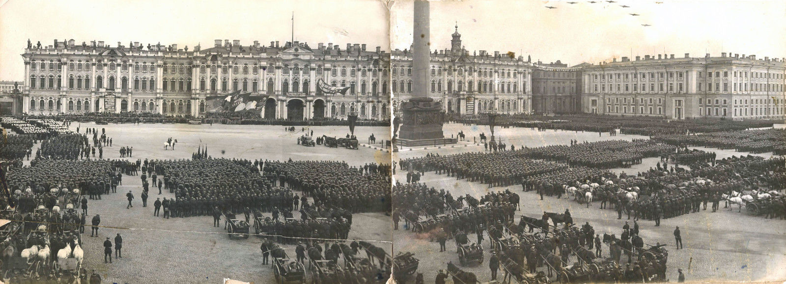 Organized columns of workers paraded in the streets of towns and cities, with music and political slogans relayed through loudspeakers. /  Panoramic view. May 1, 1930 in Leningrad (now St. Petersburg)