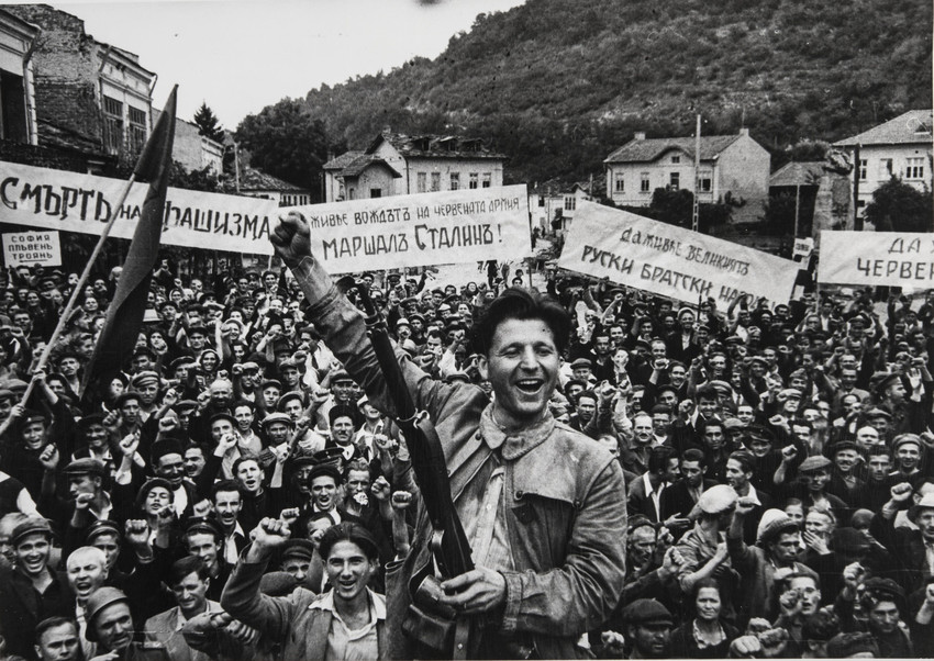 Yevgeny Khaldei is not very famous, but he is one of World War II's greatest frontline photographers. / Elated Bulgaria. Guerilla Warrior Kocha Karajev, 1944.