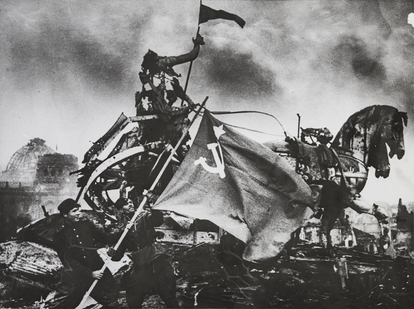 Interest in his work picked up towards the end of his life and, in 1995 at the Perpignan International Festival of Photojournalism, he was awarded the title of Knight of the Order of Arts and Letters, one of France's highest cultural awards./  The flag of victory on the Brandenburg Gates, Berlin, 1945.