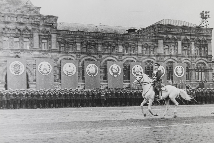 He continued working until his death, processing rolls of film in his own darkroom at home using equipment dating back to the war years.  / On the Parade Victory. George Zhukov reviews the troops, Moscow, 1945.