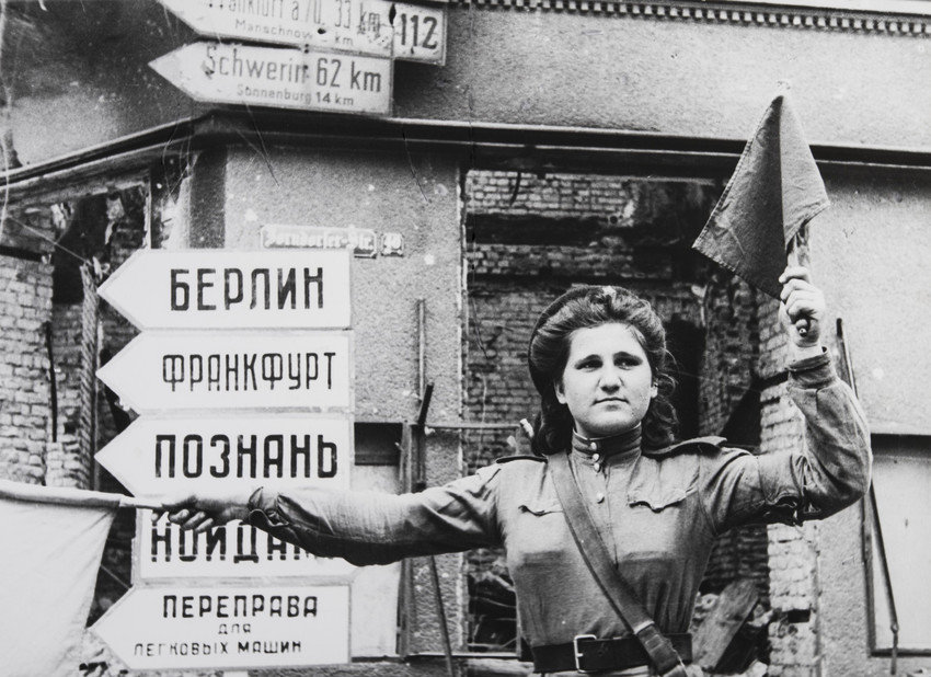 And yet this was a man whose iconic images of the Red Army's campaign to push the Nazis back across Eastern Europe as far as Berlin, were as famed worldwide as he himself as a personality was unknown. / Traffic-Controller Anna Batianova. Germany, Kustrin, 1945.
