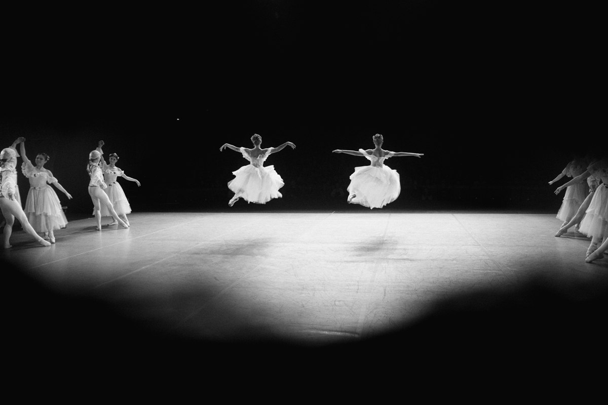 In her photos ballet dancers are delicate nymphs and graceful swans soaring above the stage. But a closer look reveals that every movement requires untold effort.