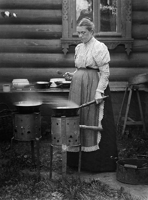 "After the Revolution, everything changed. Such estates were branded as ""bourgeois"" and confiscated by the state. Life in the new Russia required everyone to work, not sit around sipping tea and strolling along leafy paths. / Cooking jam at the dacha, 1900."
