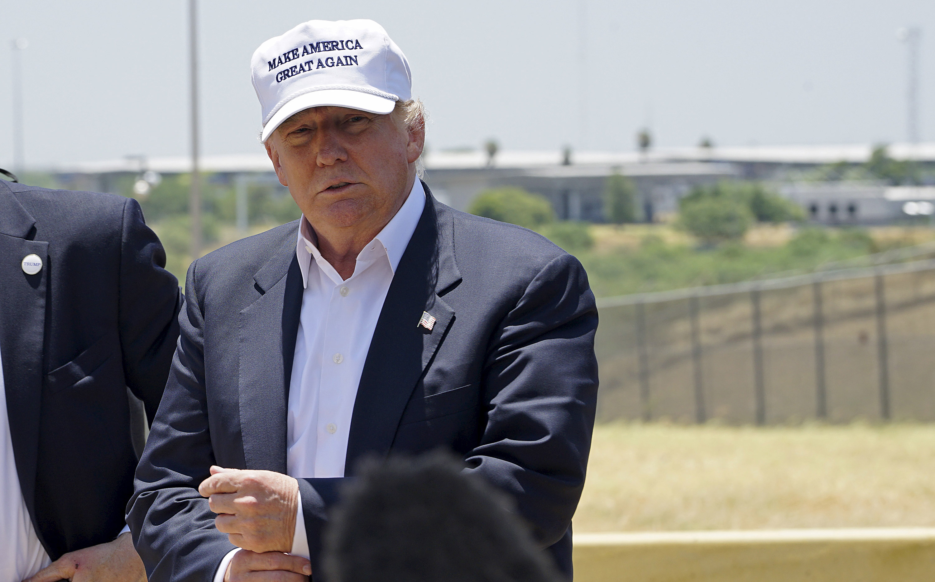 Republican presidential candidate Donald Trump attends a news conference near the U.S.-Mexico border (background), outside Laredo, Texas July 23, 2015.