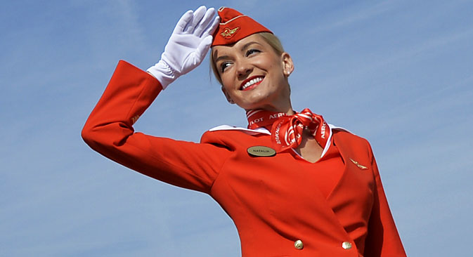 A member of Cabin crew of the Russian airline Aeroflot salutes to visitors. Source: AFP / East News