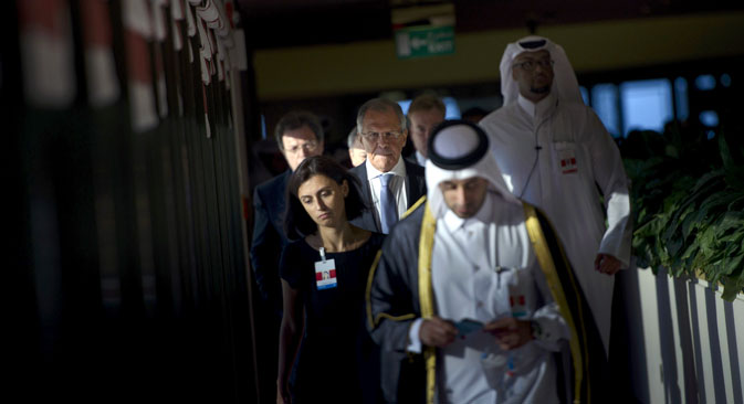 Russia's Foreign Minister Sergey Lavrov (C) walks with others before a trilateral meeting in Doha, Qatar