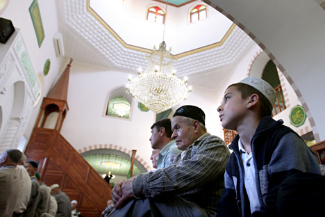 Muslims pray at the Kebir-Jami Mosque in Simferopol, Crimea, celebrating Eid al-Fitr that marks the end of the holy month of Ramadan.
