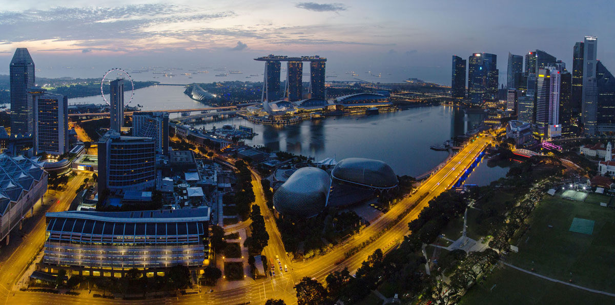 Night panorama of the Marina Bay. This district is a modern symbol of Singapore. It was built in the beginning of the 21st century on reclaimed land.