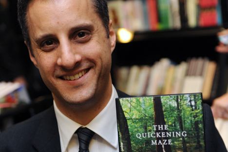 Man Booker Prize for Fiction 2009 shortlisted author Adam Foulds poses with a copy of his book 'The Quickening Maze'
