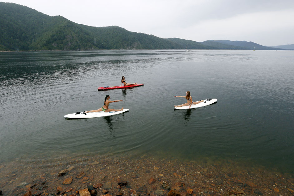 Girls practice board yoga on the Yenisei River outside the Siberian city of Krasnoyarsk, on Aug. 24. Source: Reuters