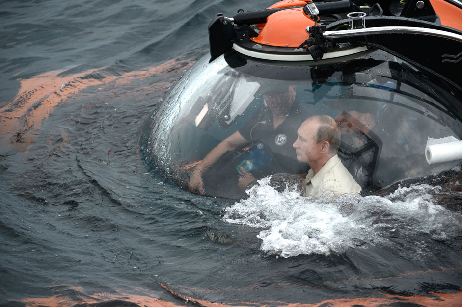18 August 2015. Russian President Vladimir Putin (foreground) on a submersible dive to the sunken ancient ship, which lies near Sevastopol in the 83-meter depth. President takes part in the expedition as part of events dedicated to the 170th anniversary of the Russian Geographical Society (RGS)
