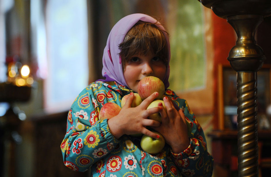 Russia. Ryazan. 19 August 2015. The girl in the Church of the Transfiguration on Yar during the celebration of the Transfiguration (Feast).