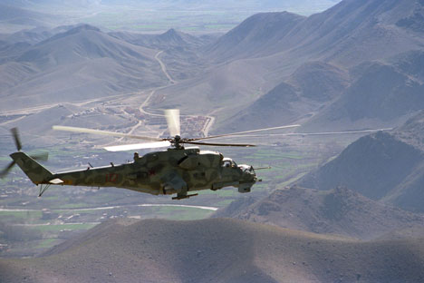 A Mi-24 helicopter on a mission in the vicinity of the Kabul-Herat road.