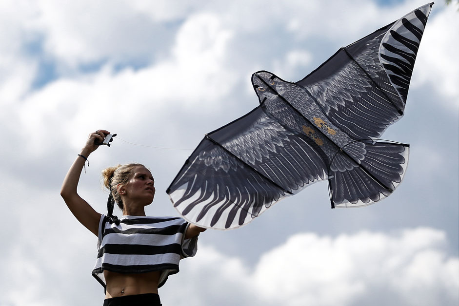 MOSCOW, RUSSIA. AUGUST 2015. A young girl flies a kite during a summer kite festival in the Setun River Valley nature reserve