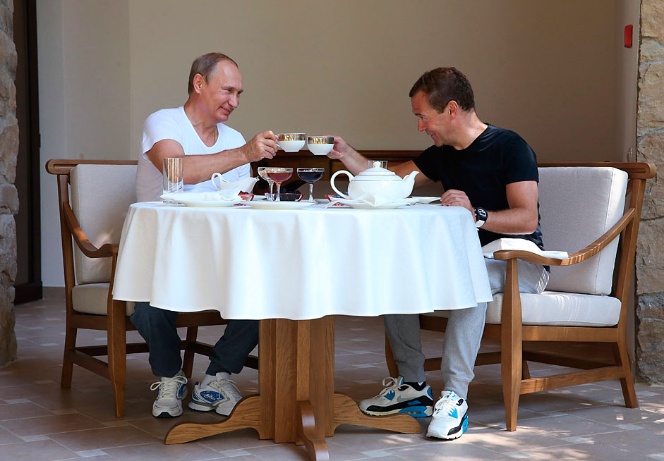 Russian President Vladimir Putin, left, and Prime Minister DmitryMedvedev make a toast while having lunch during their meeting at the BlackSea resort of Sochi, Russia, Sunday, Aug. 30, 2015.