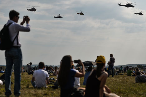 Spectators watching indicative span group of helicopters at the International Aviation and Space Salon MAKS 2015 in Zhukovsky near Moscow.