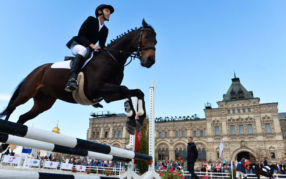 "Member of show jumping ""Life, not just a sport"" in the framework of the International Military Music Festival ""Spasskaya Tower"" in the equestrian arena Kremlin riding school, posted on the Red Square in Moscow on Aug. 20, 2015."