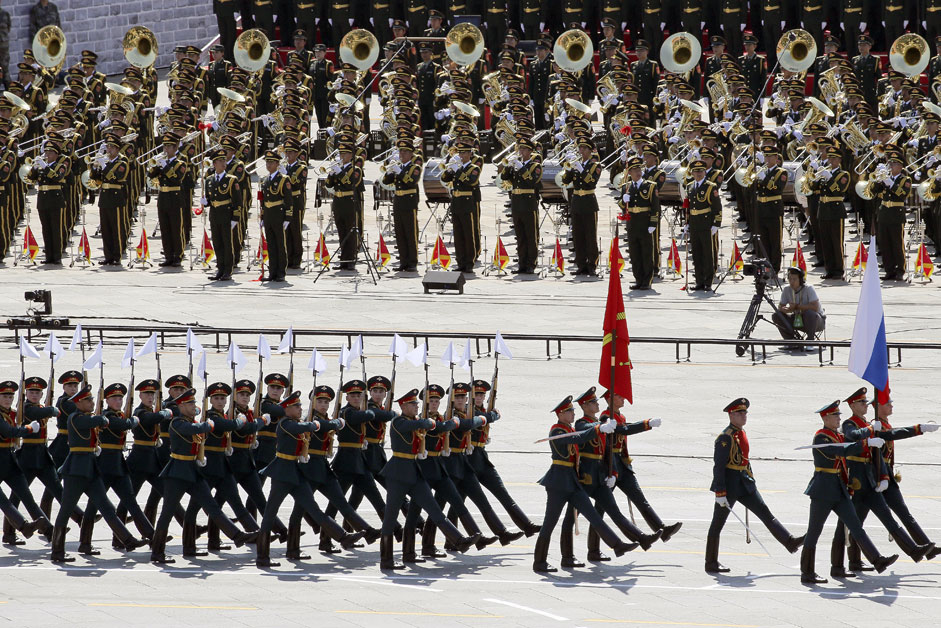 Russian soldiers march as the military band plays during a military parade to mark the 70th anniversary of the end of World War Two, in Beijing, China, September 3, 2015.