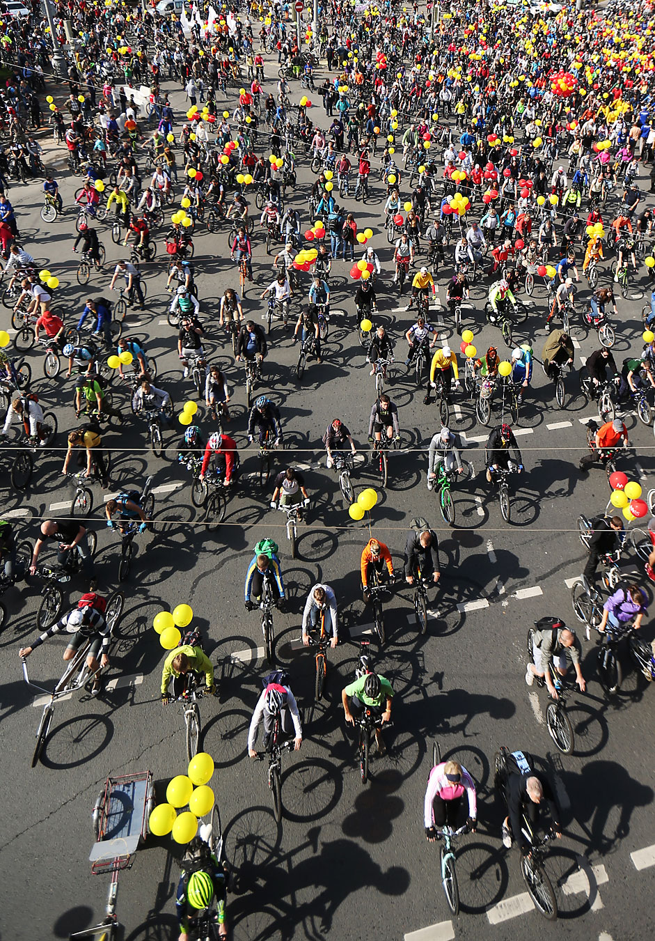 Participants in a bicycle parade for development of cycling infrastructure and road safety on Moscow City Day.
