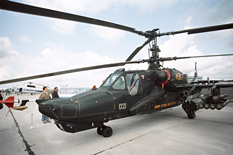 The Ka-50 one-seater army combat helicopter Black Shark on an airfield