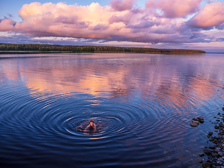 A woman is bathing in Lake Yanisyarvi in Ruskeala mountain park in Karelia, Russian North, on Sept. 5
