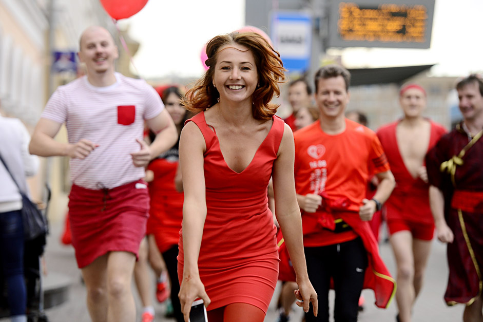 Participants wearing red dresses run during the Red Dress Run in Moscow, Russia
