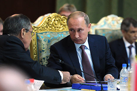 Russian President Vladimir Putin attends extended meeting of regular session of the Collective Security Council of the CSTO at the Palace of Nations in Tajikistan. Left: Russian Foreign Minister Sergey Lavrov. Background right: Deputy Russian Security Council Secretary Rashid Nurgaliyev.