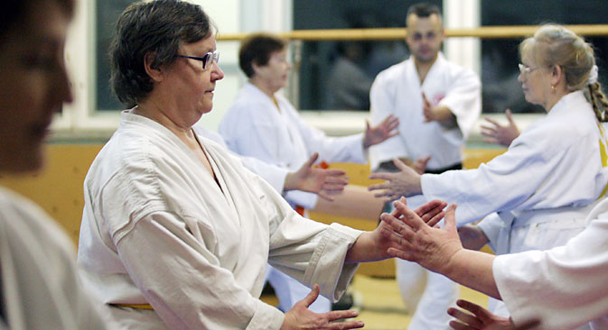 Elderly people at aikido training, Novosibirsk. Source: TASS / Alexei Fyodorov