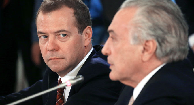 Russian Prime Minister Dmitry Medvedev, left, and Federal Republic of Brazil's Vice President Michel Miguel Elias Temer at a news conference on the results of the 7th meeting of the Russian-Brazilian High-Level Commission on Cooperation that is held in Moscow.