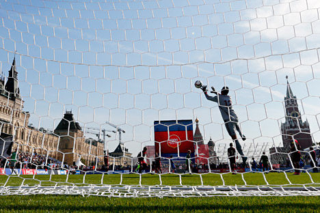 Soccer players perform at a soccer park installed at Red Square before the unveiling ceremony for the clock counting down 1000 days to go until the 2018 FIFA World Cup at the Manezhnaya square in Moscow, Russia, 18 September 2015.