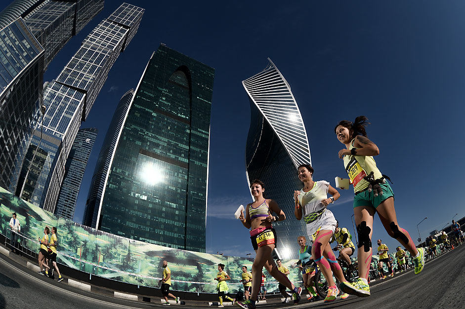 Participants of the Moscow Marathon in front of the Moscow City business center.