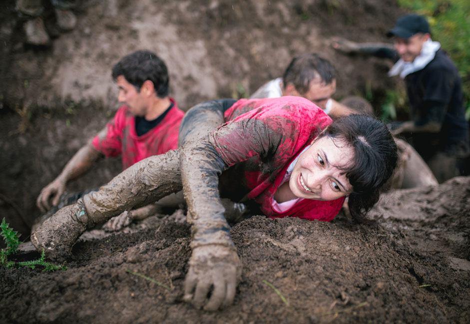 "Russia. Ufa. 21 September 2015. The participants of sports and extreme games ""Crazy Race"" are an obstacle on the terrain"