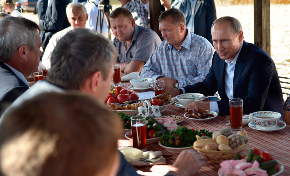 Russian President Vladimir Putin, right, meets with farmers in the village of Shaminka in Rostov region, Russia, Thursday, Sept. 24, 2015.