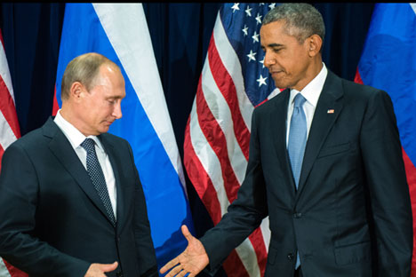 Russian President Valdimir Putin (L) and US President Barack Obama (R) shake hands for the cameras before the start of a bilateral meeting at the United Nations headquarters in New York City, New York, USA, 28 September 2015.