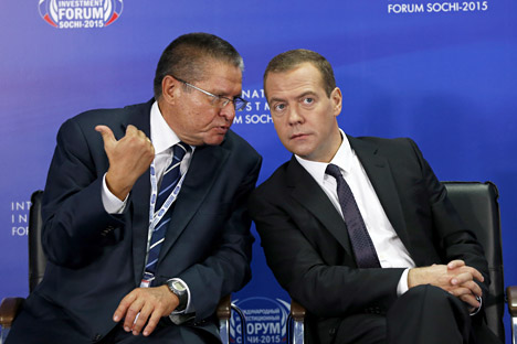 Russian Prime Minister Dmitry Medvedev (right) and Minister of Economic Development Alexei Ulyukayev attend the round table 'Investment Climate At The Local Level. Keys To Success' at the International Investment Forum Sochi 2015.