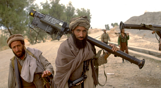 1989. Mujahedeen w. Amer. made stinger missile on shoulder during rebel assault on Jalalabad