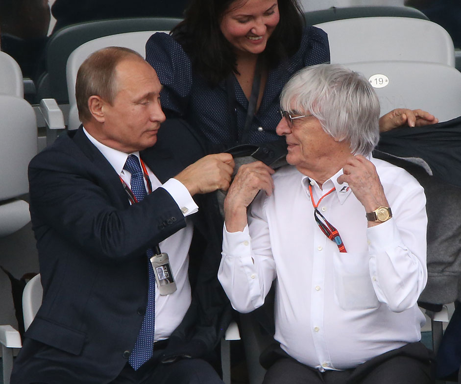 Russian President Vladimir Putin and F1 Supremo Bernie Ecclestone attend the Formula 1 Russian Grand Prix competition October 11, 2015 in Sochi