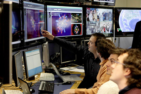 Scientists looking at the first collisions pictures at full power at the CMS experience control room at the European Organisation for Nuclear Research (CERN) in Meyrin near Geneva, Switzerland. Source: EPA